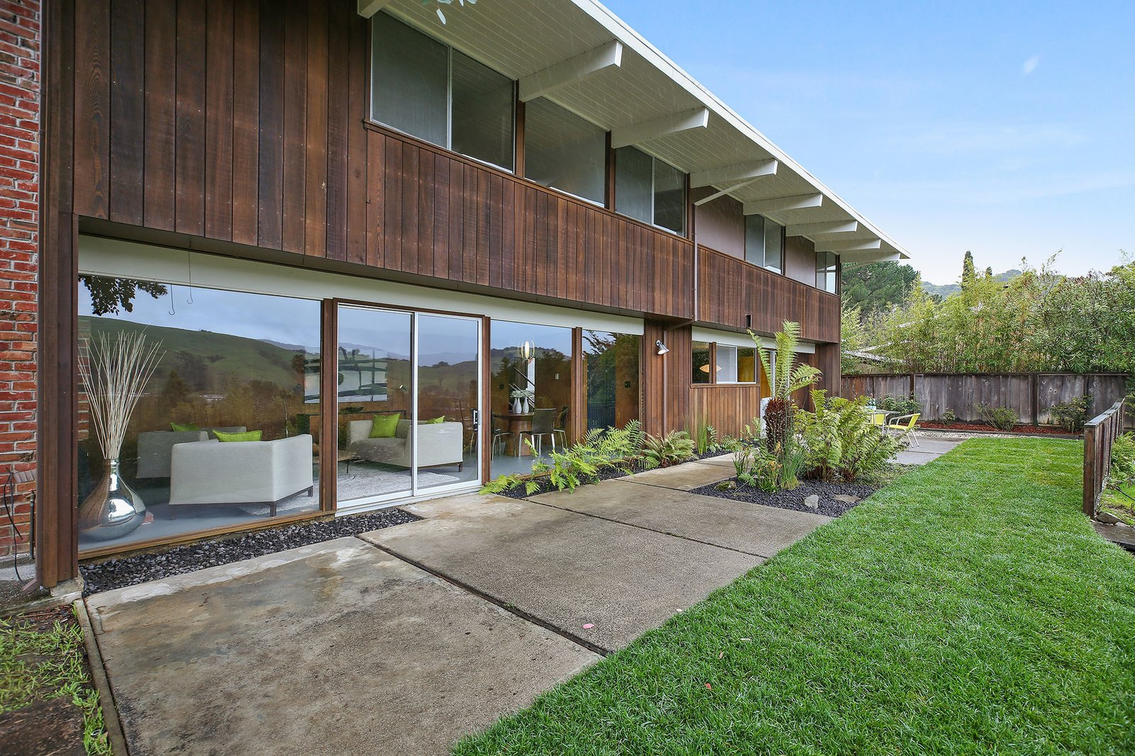 Outdoor, Small, Grass, Gardens, Back Yard, Vertical, Wood, and Shrubs A look at the rear of the home.  Best Outdoor Vertical Gardens Photos from This Rare Two-Story Eichler Has Just Been Listed For $1.35M