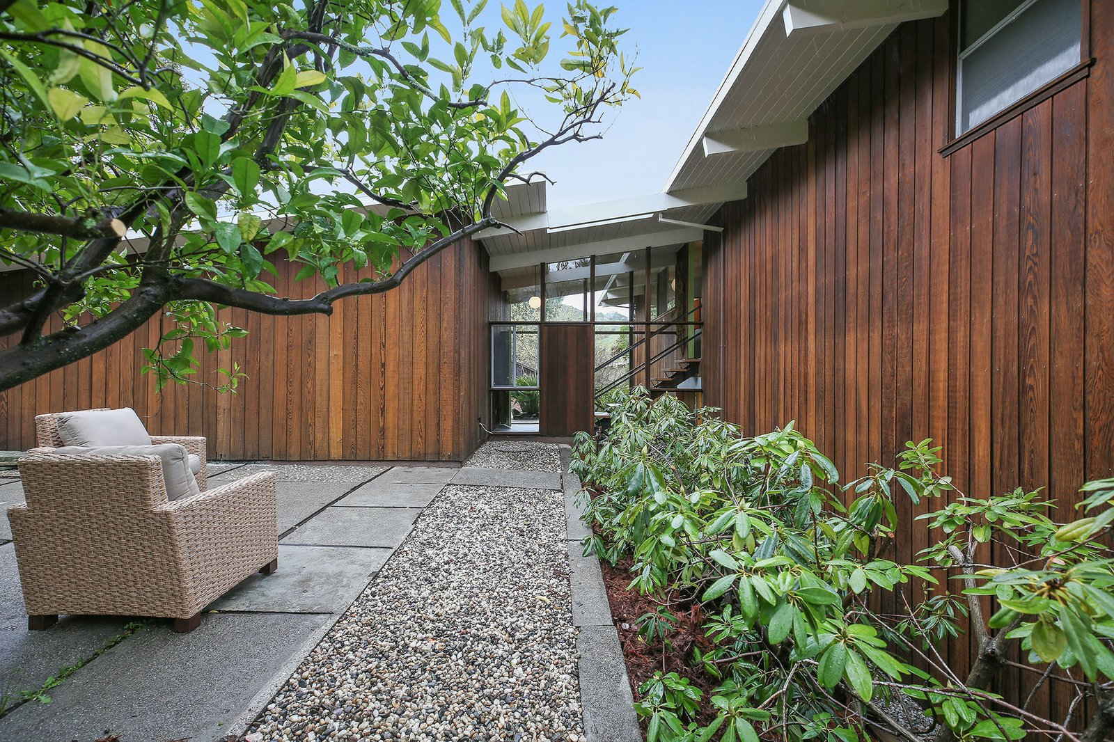 Exterior, Mid-Century Building Type, House Building Type, Wood Siding Material, and Flat RoofLine The home has a strong connection to the outdoors, despite missing the central a  Photo 15 of 15 in This Rare Two-Story Eichler Has Just Been Listed For $1.35M