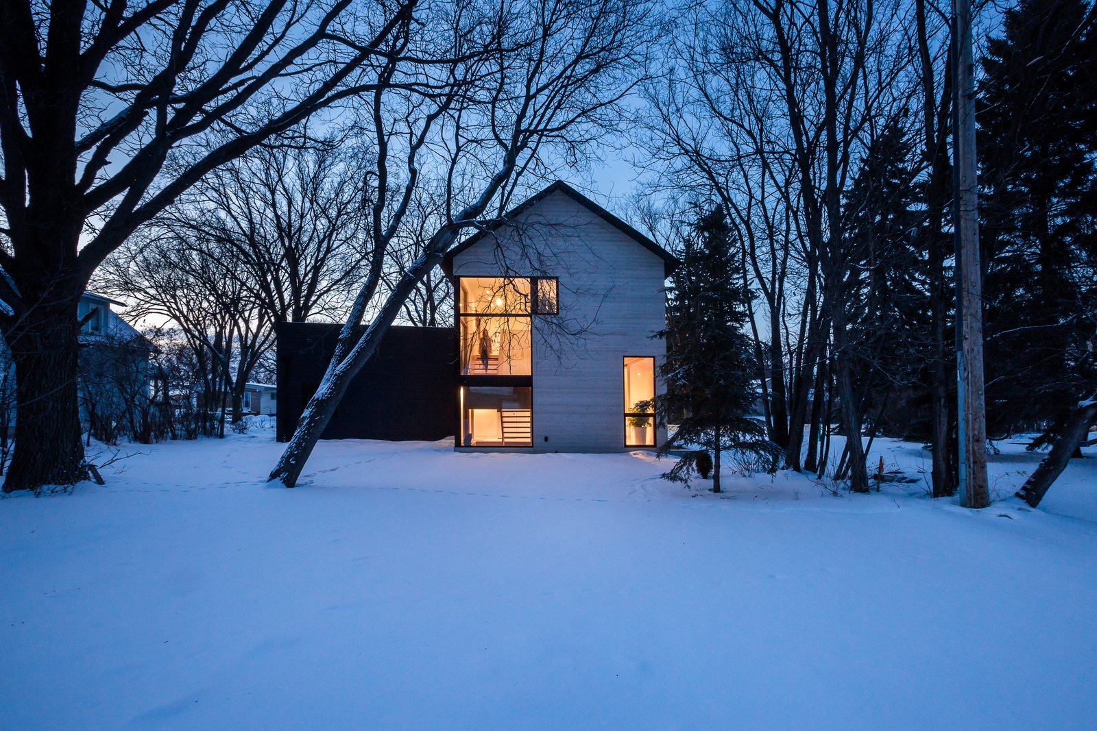 Exterior, Flat RoofLine, House Building Type, Wood Siding Material, and Gable RoofLine Duerksen now runs his own architecture firm out of the home.  Best Photos from An Intern Architect Builds a Home For His Growing Family on a Strict Budget