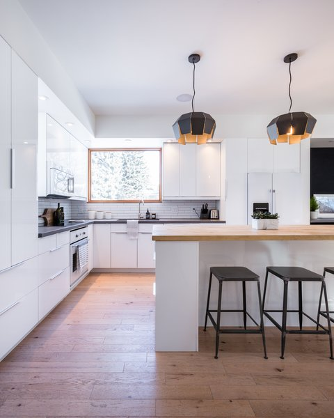 The open plan of the white kitchen helps keep the interiors bright, while also creating a greater sense of spaciousness.