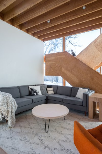 "The staircase is constructed of laminated 3/4"" plywood sheets, and all of the components are interlocking using mortise and tenon joints instead of fasteners."