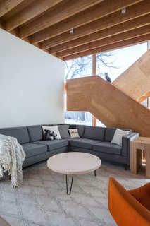 """The staircase is constructed of laminated 3/4"""" plywood sheets, and all of the components are interlocking using mortise and tenon joints instead of fasteners."""