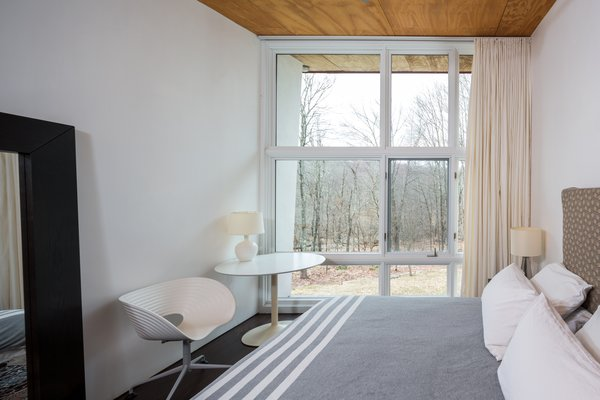 Two bedrooms and a full bath are located on the main floor, with the master bedroom suite on the second level.