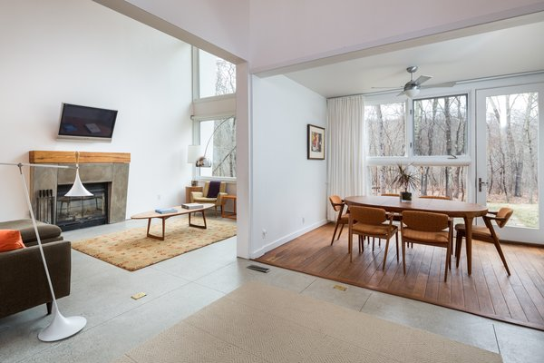 Meticulous positioning for solar energy keeps the home warm in winter, along with the floor-to-ceiling windows that help heat it during the day.