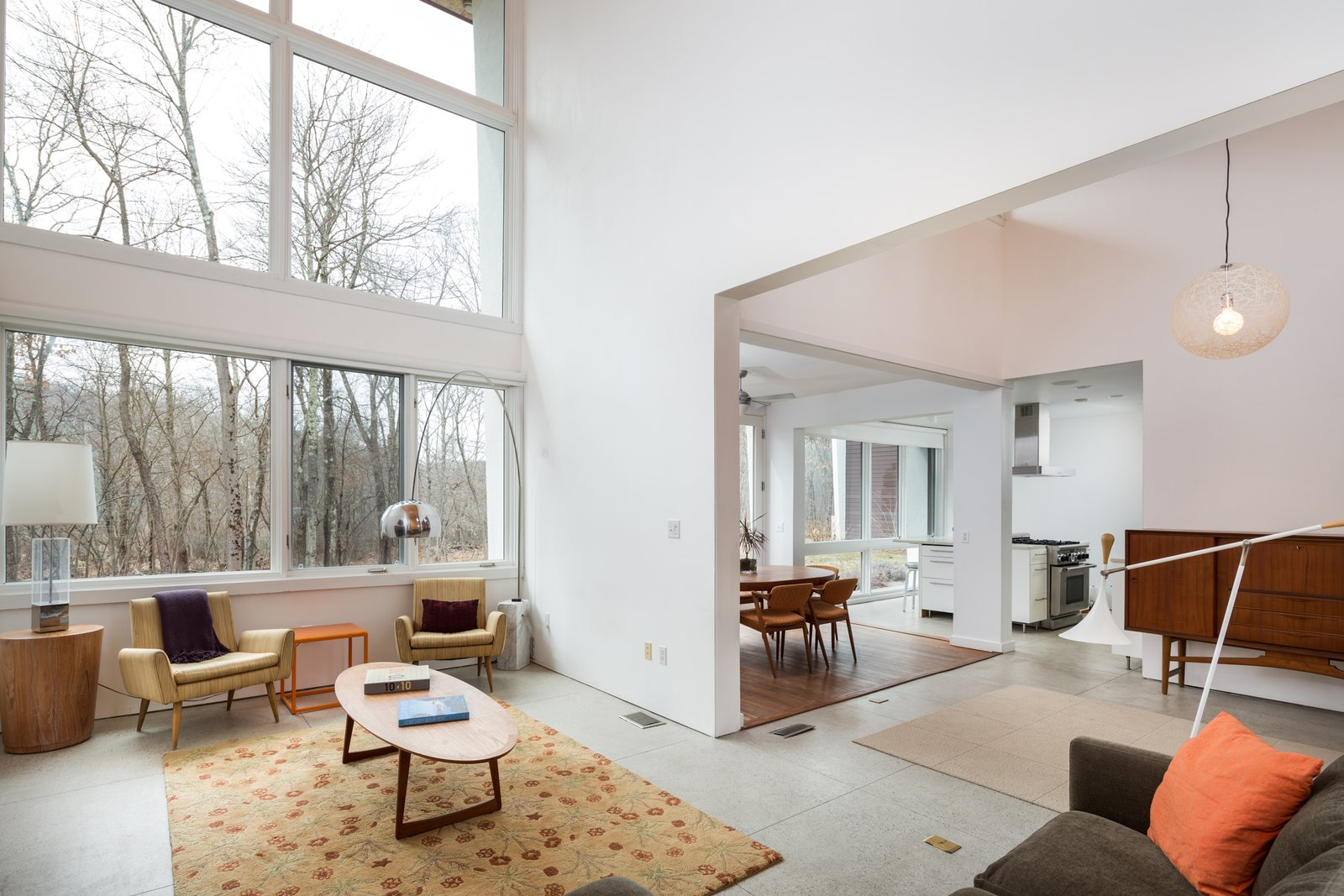 The open layout on the main level includes the living room with a fireplace, the dining room, and the kitchen.