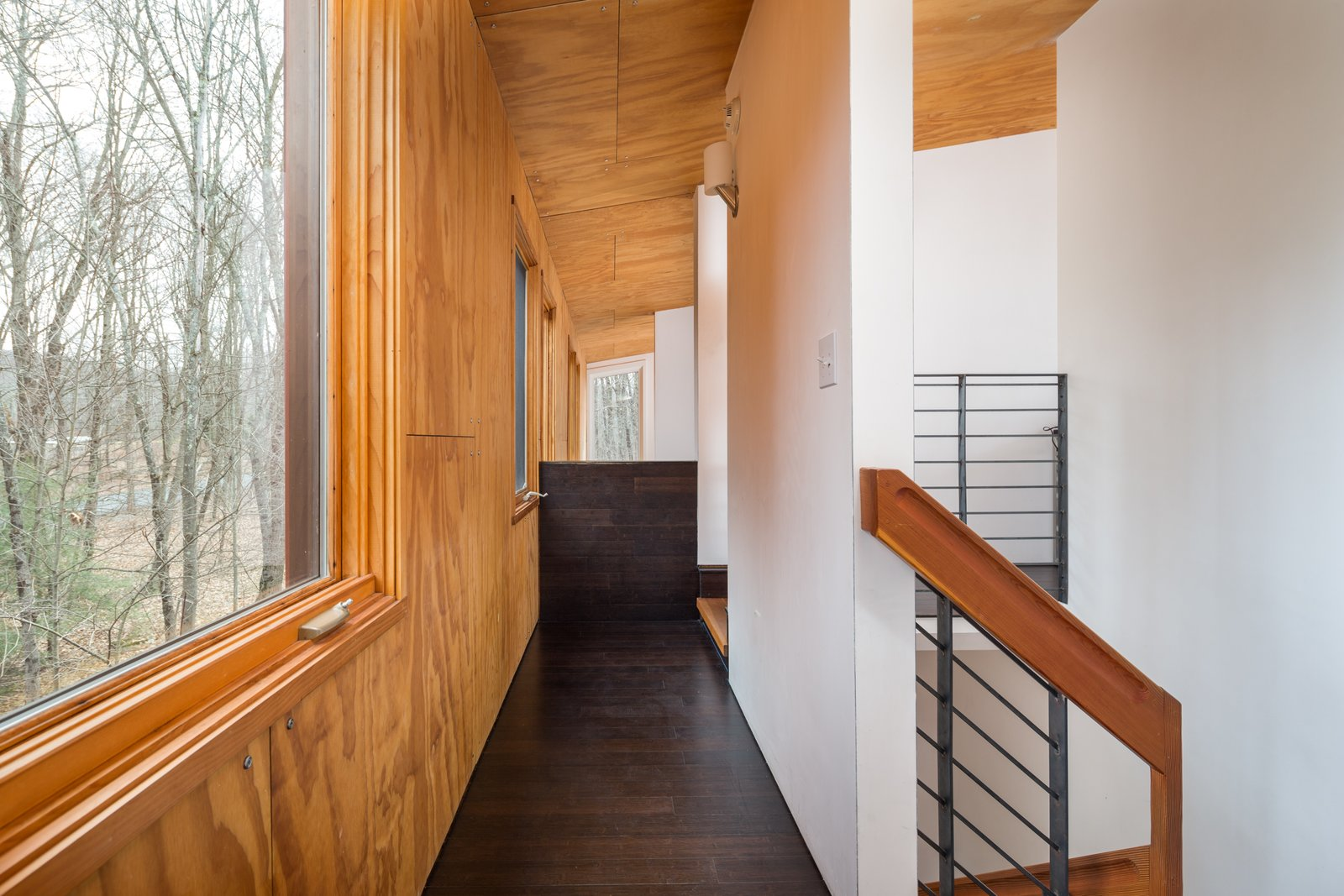 The large windows bring in so much natural light that the home rarely needs electrical lighting throughout the daytime.