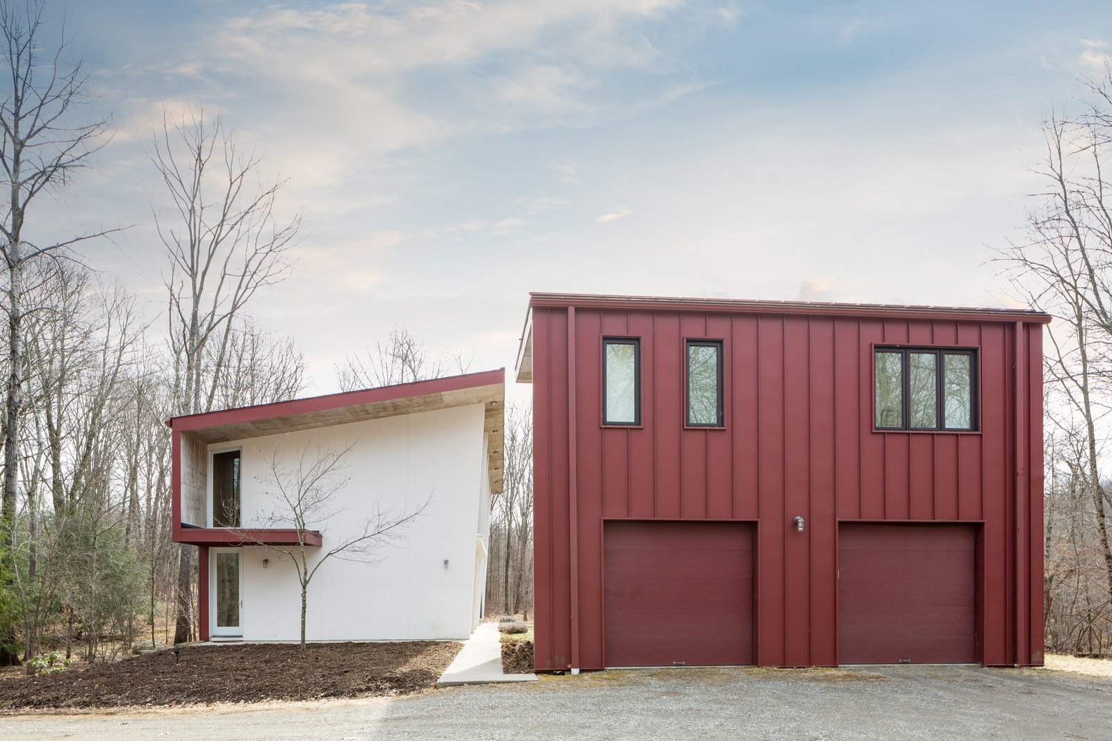Above the two-bay garage is a guest apartment (approximately 600 square feet.) that features a sleeping alcove, kitchen, bath, living room, laundry area, gas fireplace, and balcony.