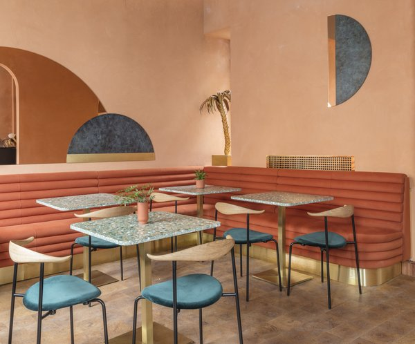 The dining chairs are from Carl Hansen. Terrazzo tables pick up on the design of the bar which utilizes the same material.
