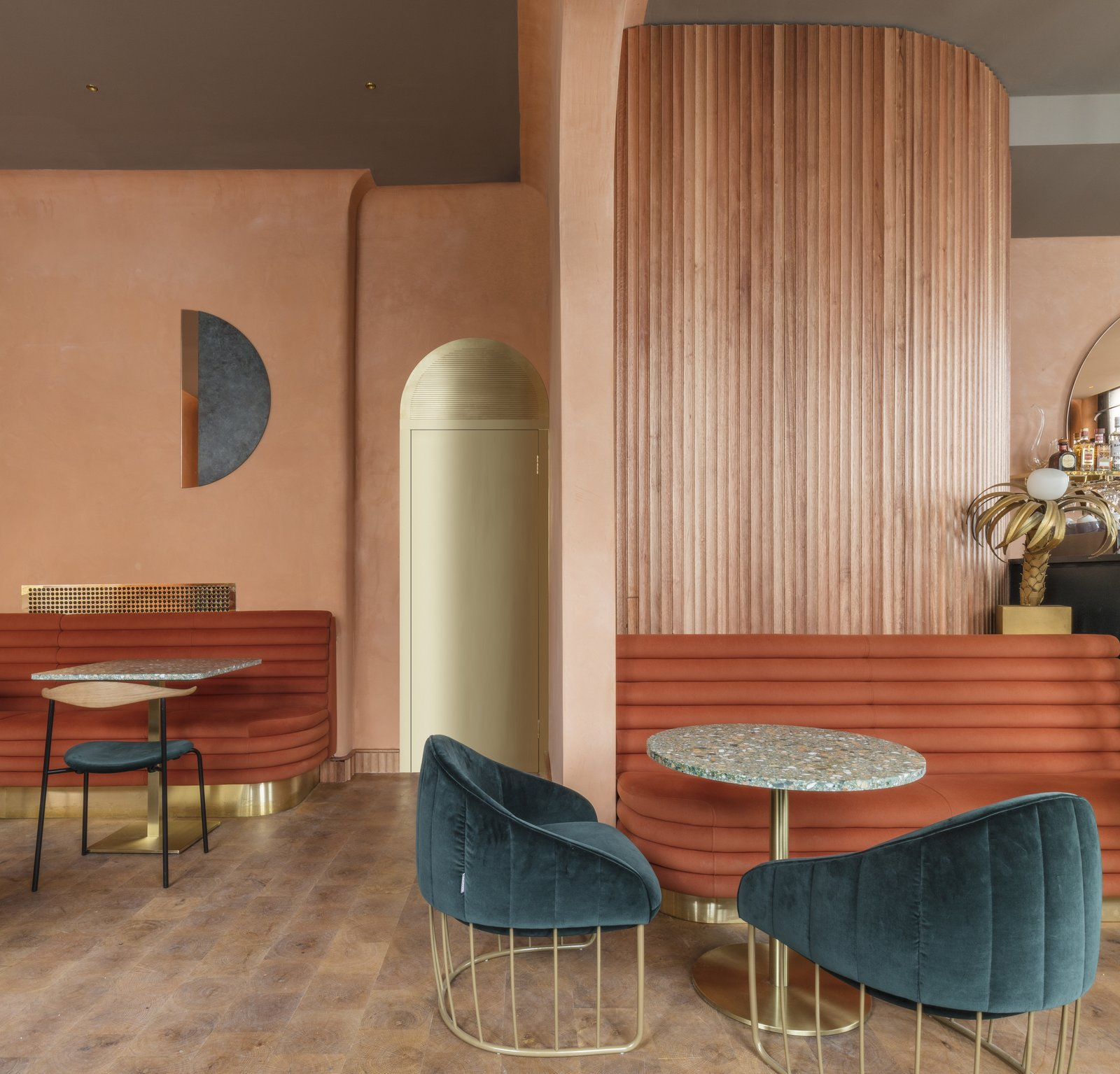 A circular motif echos throughout the design of the warm and modern space.