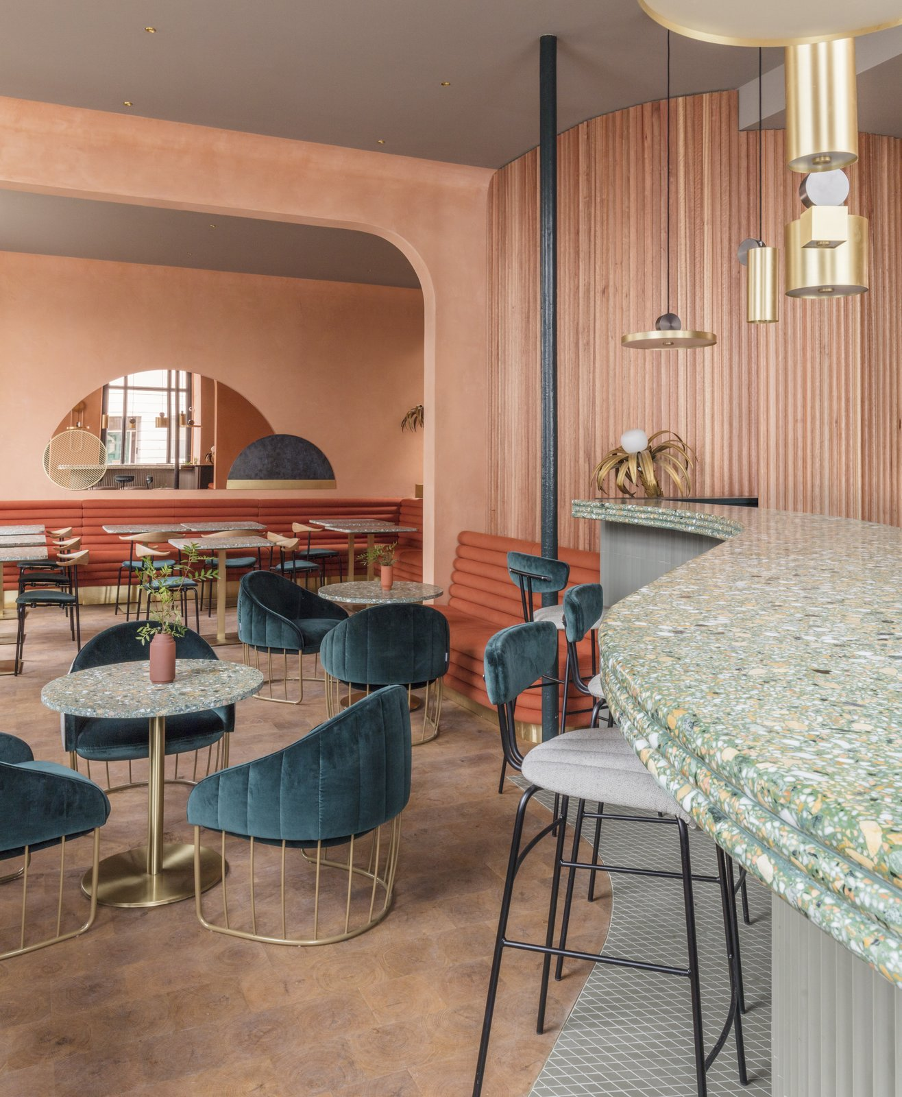 Dining Room, Table, Pendant Lighting, Stools, Chair, Medium Hardwood Floor, and Bar The menu features creations from Mallorcan-born Michelin-kitchen veteran chef Vicente Fortea.  Photo 7 of 8 in A Historic London Property Is Converted Into a Modern Mediterranean Eatery