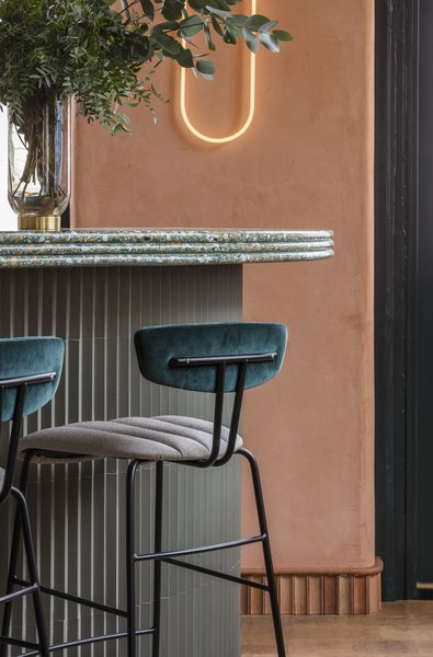 The paneling on the bar is Mutina Rombini tiles by Ronan and Erwan Bouroullec.