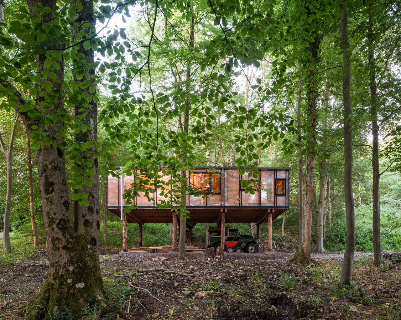 Exterior, Wood, Flat, House, Glass, and Cabin The constraints informed the building design, and were embraced—for example, the cladding that was milled at the end was only enough to partially clad the studio.  Best Exterior Wood Glass Cabin Flat Photos from 10 Buildings We Love by Piers Taylor