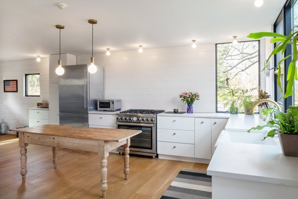 The bright open kitchen has a farmhouse feel.