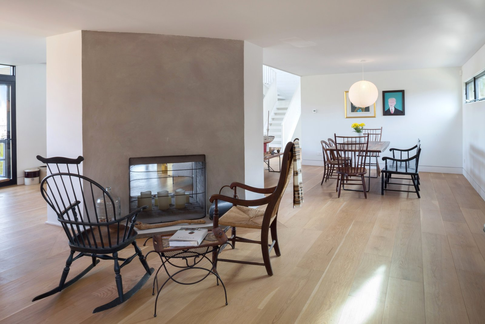 Living, Light Hardwood, Chair, Two-Sided, Table, and End Tables The backside of the home's double-sided fireplace.  Living Table Two-Sided Photos from A Renovated Farmhouse in the Hamptons Hits the Market at $2.8M
