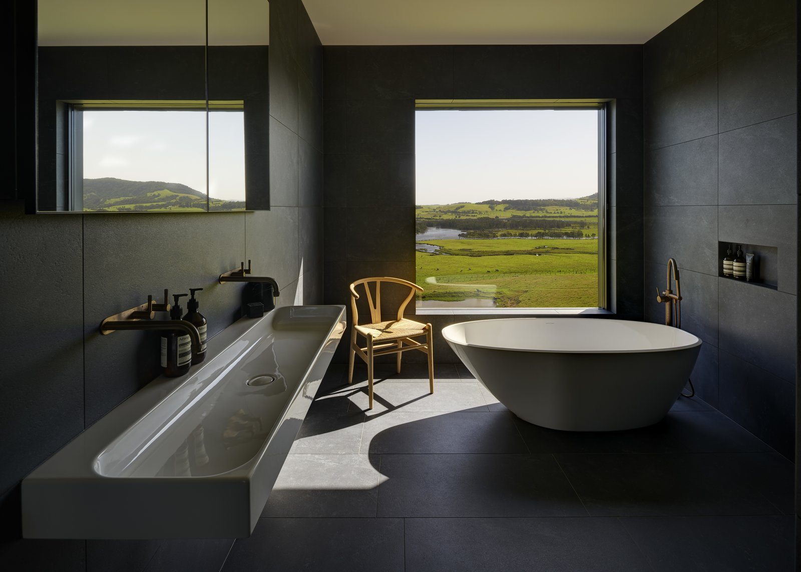 Bath, Slate, Stone Tile, Wall Mount, Soaking, Freestanding, and Drop In A simple soaking tub makes for a zen-like bath experience with a view.  Best Bath Drop In Soaking Photos from An Australian Abode Fuses Structure With Scenery