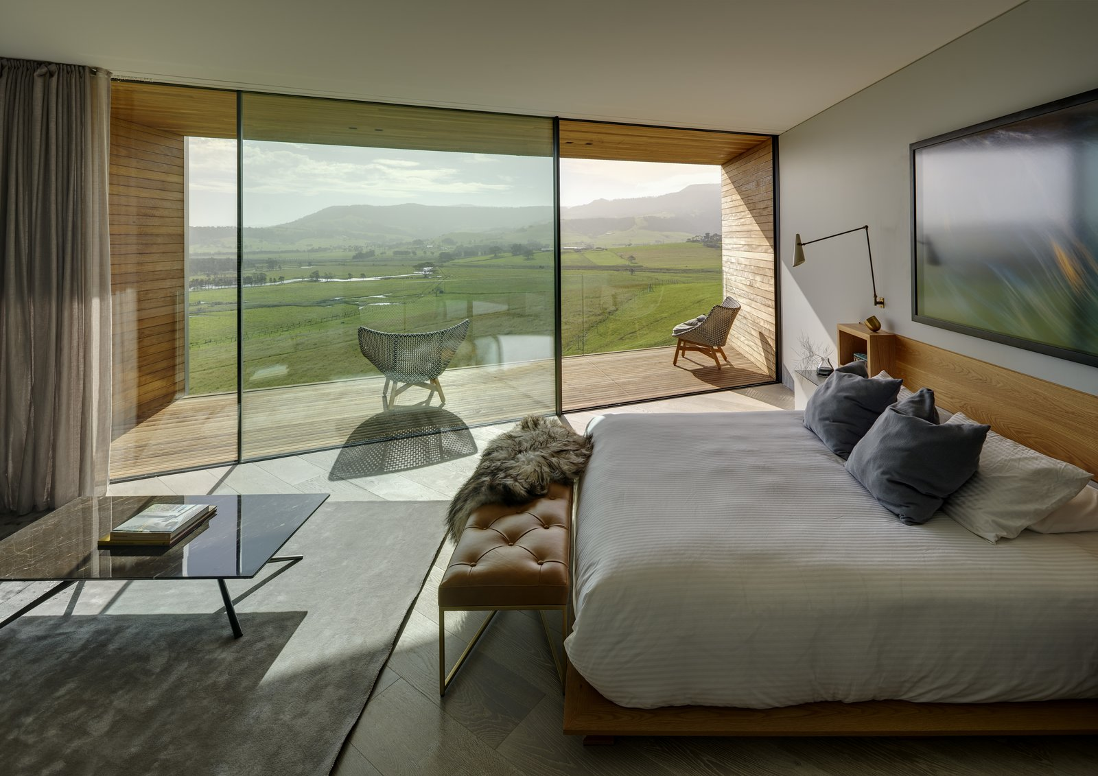 Bedroom, Night Stands, Bed, Wall, Light Hardwood, Rug, and Bench The bedroom view.  Best Bedroom Wall Bed Rug Light Hardwood Photos from An Australian Abode Fuses Structure With Scenery
