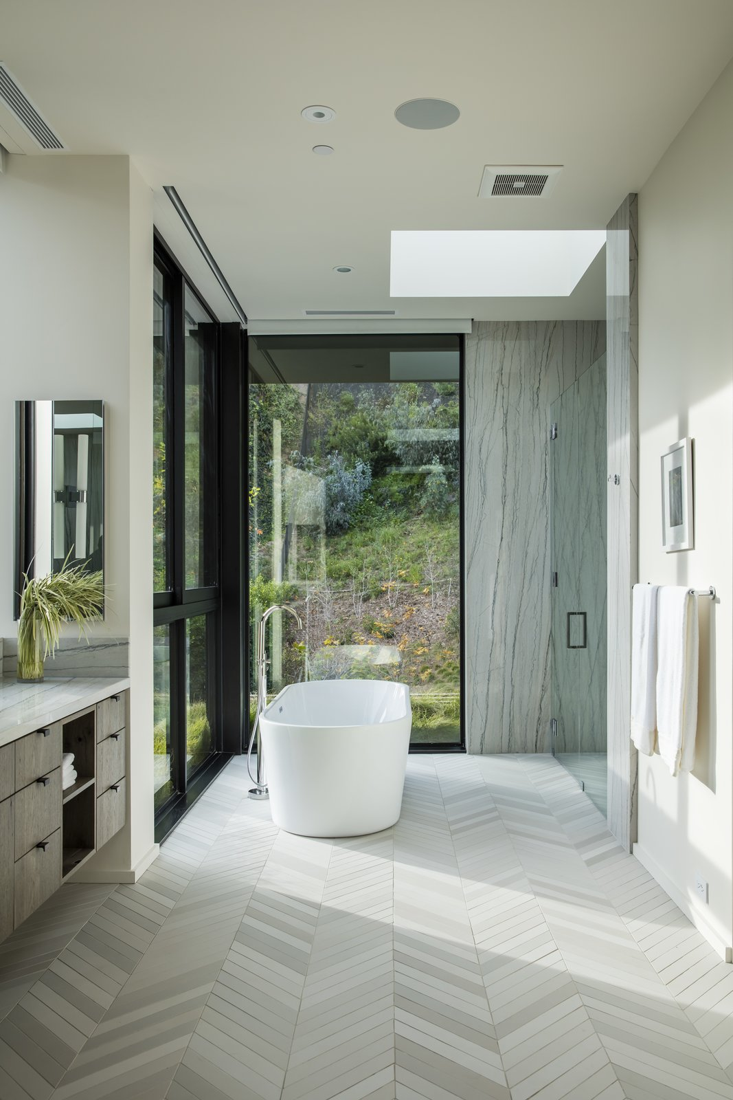 Bath Room, Ceramic Tile Floor, Freestanding Tub, Soaking Tub, Enclosed Shower, and Recessed Lighting Even the bathrooms have a strong sense of the outdoors.  Photo 10 of 13 in Live Large in This Marmol Radziner–Designed Home That's Asking $16.9M