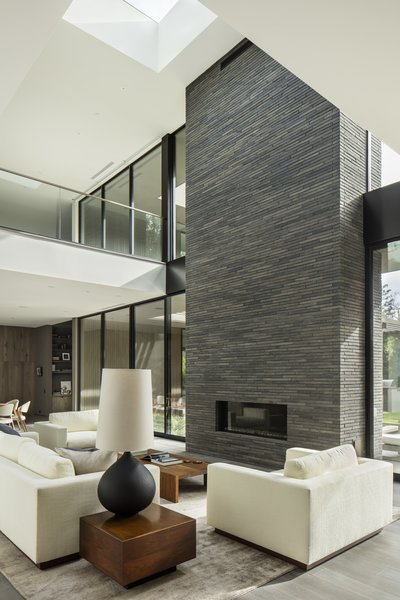 The brick-inlay structure anchors the open-plan living room.