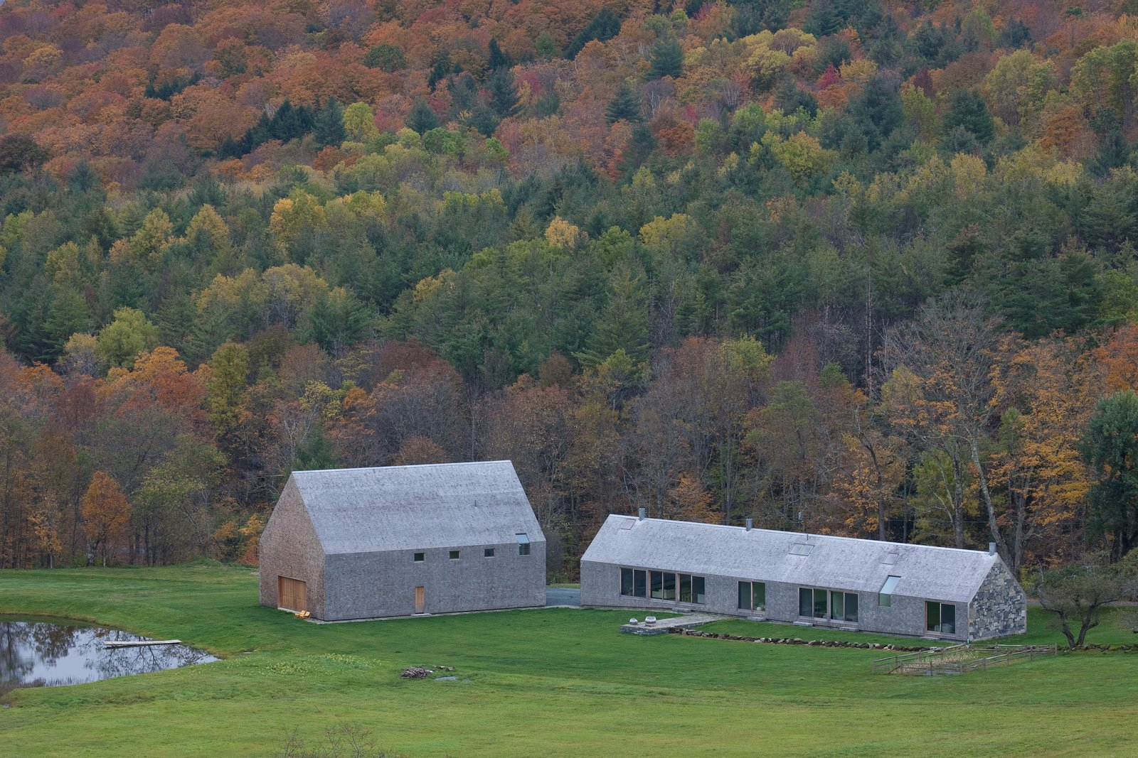Exterior, Gable, Stone, Barn, Farmhouse, Shingles, Wood, and House The home is naturally integrated into its bucolic setting.  Best Exterior Wood Farmhouse Photos from A Minimalist, Rick Joy–Designed Farmhouse in Vermont Asks $9.25M