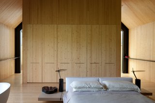 Clad in locally-sourced pine, the bedroom has a Shaker-like, minimalist aesthetic.
