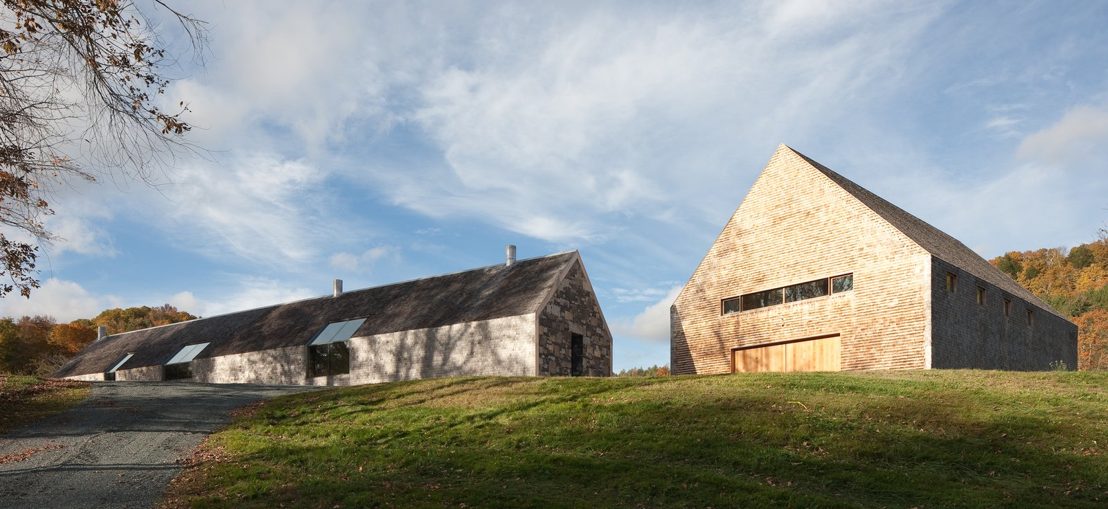 Exterior, Farmhouse, Gable, Wood, Shingles, Barn, Stone, and House The northern façade of the main house is set at an angle to the barn  Best Exterior House Barn Photos from A Minimalist, Rick Joy–Designed Farmhouse in Vermont Asks $9.25M