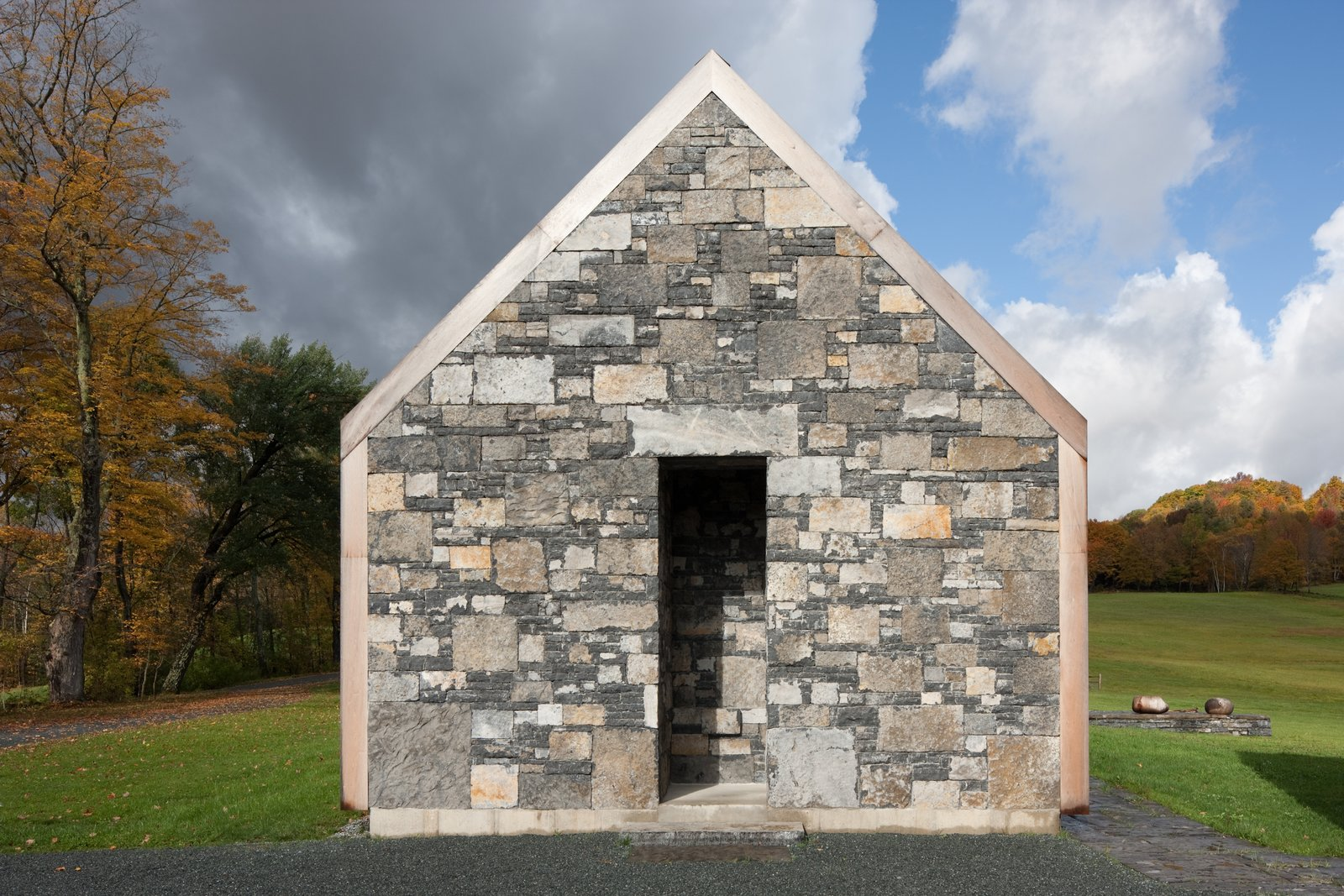 Exterior, Shingles Roof Material, Stone Siding Material, Farmhouse Building Type, Gable RoofLine, and House Building Type Vestigial stone walls that remain throughout the property, almost echoing the home's poetic use of stone.  Photo 2 of 13 in A Minimalist, Rick Joy–Designed Farmhouse in Vermont Asks $9.25M