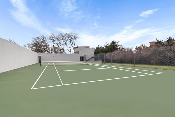 The home is one of only two properties on Bluff road with a grandfathered in tennis court on a one-acre lot.