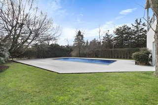 The pool and expansive lawn provide ample space for outdoor entertaining.