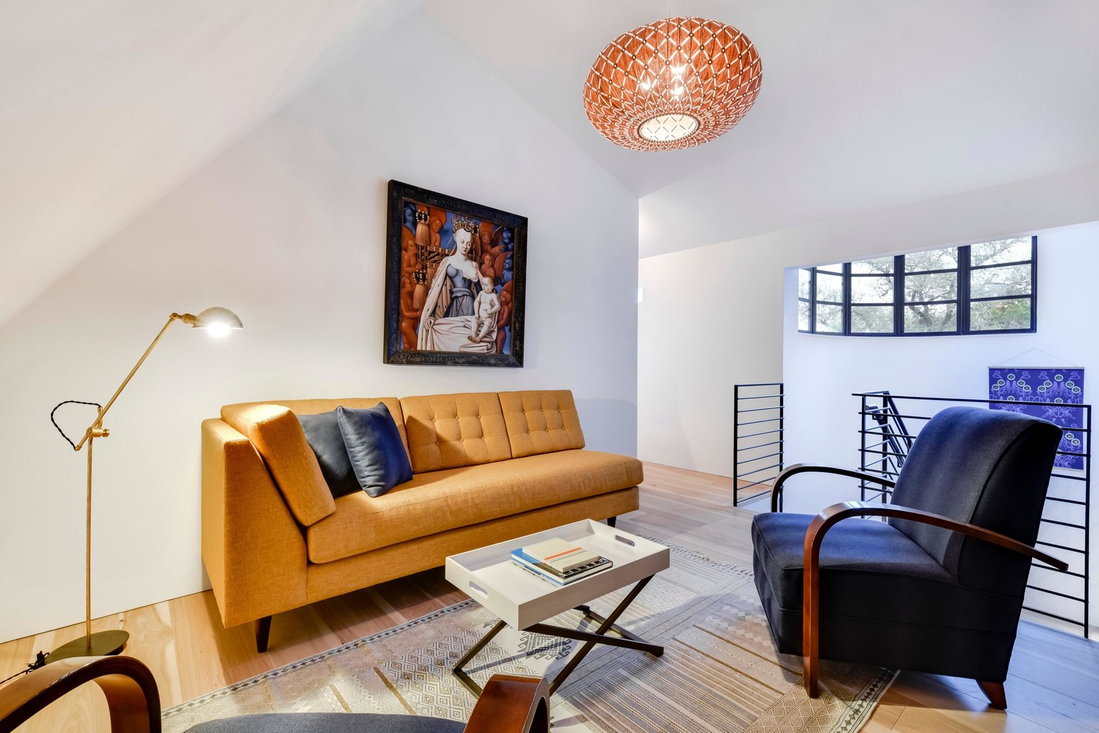 Living Room, Sofa, Chair, Medium Hardwood Floor, Pendant Lighting, Floor Lighting, Rug Floor, and Coffee Tables Designed for maximum flexibility, each of the rooms is capable of multiple uses.  Photo 11 of 22 in Own This Alluring Sculptural Abode in Austin For $3.1M