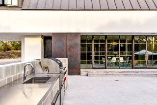 The pool area even features an outdoor kitchen.