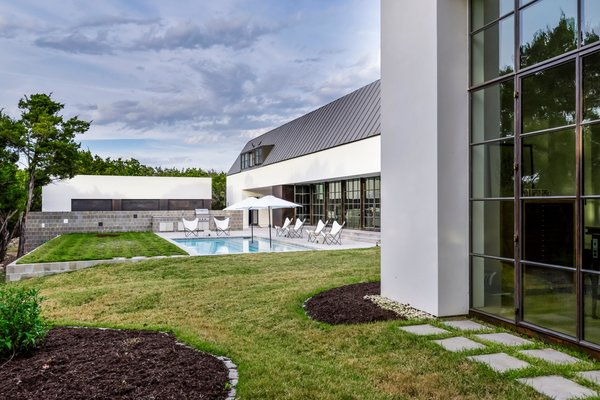 An extension of the living space is an outdoor pool and lawn.