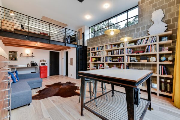 The studio is also complete with a kitchen and a sleeping loft so that it can serve as self-sufficient guest quarters.