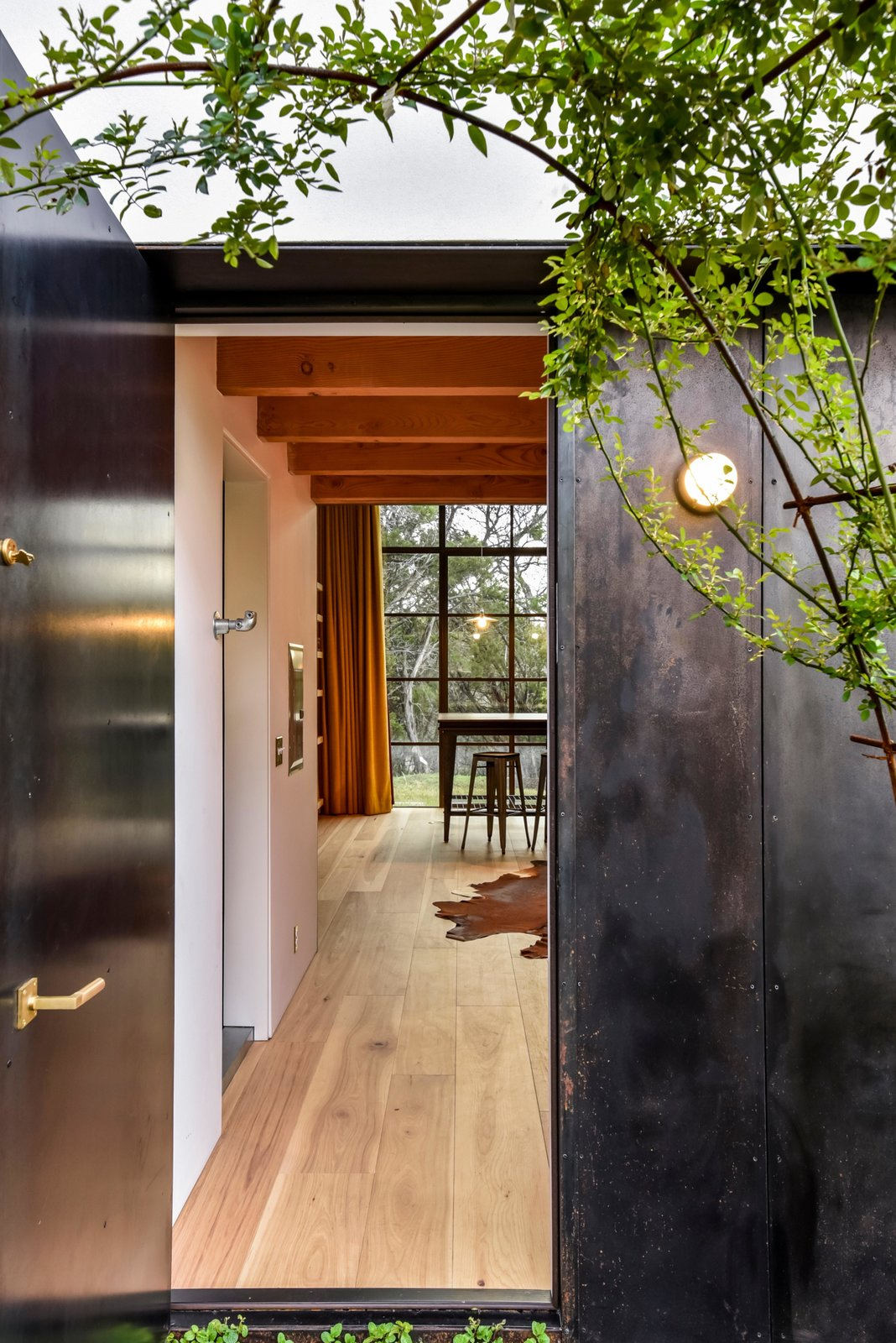 Doors, Swing Door Type, Exterior, and Metal A separate studio provides a hideaway for work or creative pursuits.  Photo 13 of 22 in Own This Alluring Sculptural Abode in Austin For $3.1M