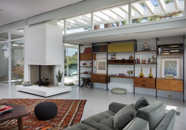 The open-plan living room is anchored by a wood-burning two-sided fireplace.