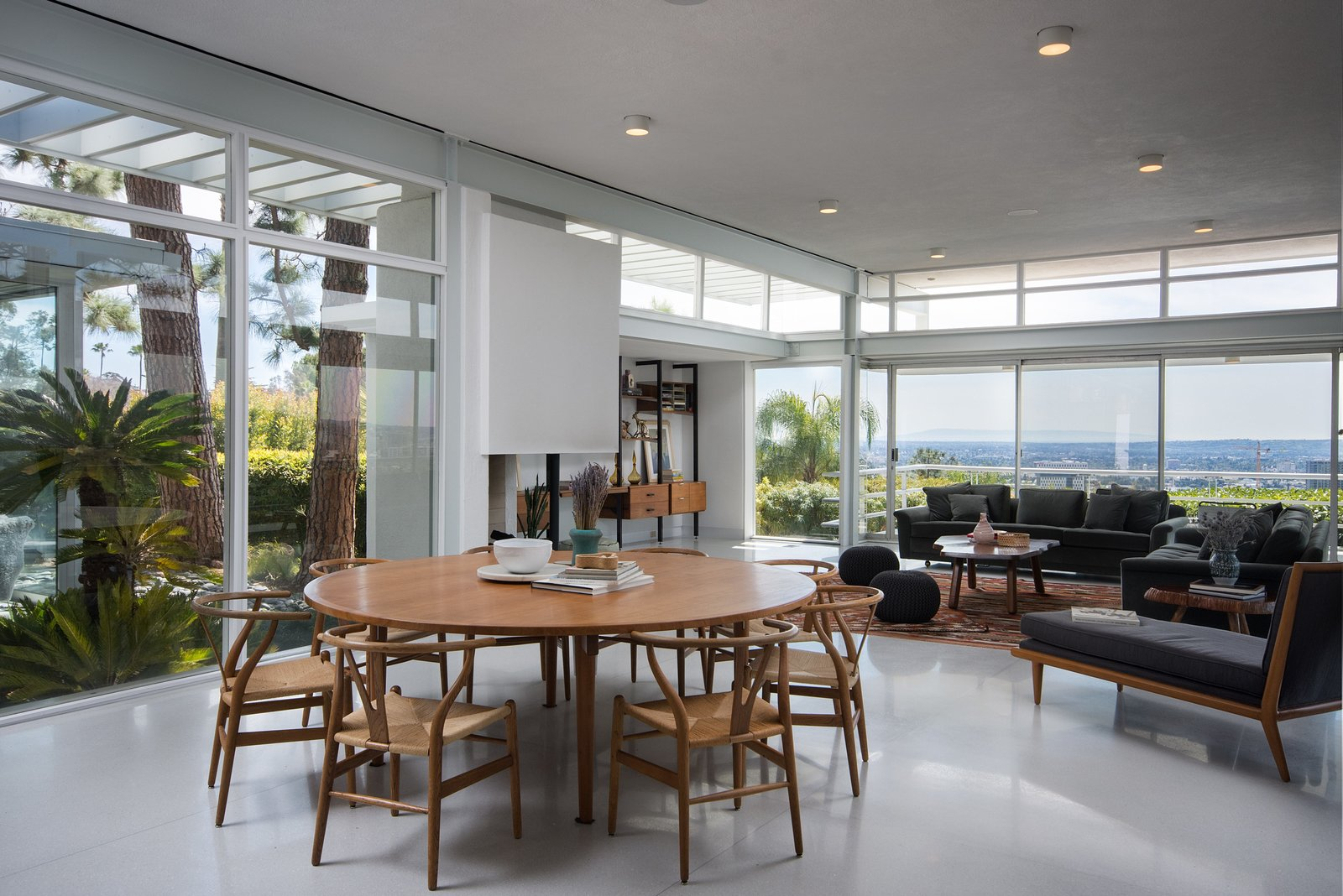 Dining, Ceiling, Table, Corner, Chair, and Wood Burning Every corner of the home offers stunning views.  Dining Corner Photos from Rooney Mara Asks $3.45M For a Restored Midcentury Stunner in L.A.