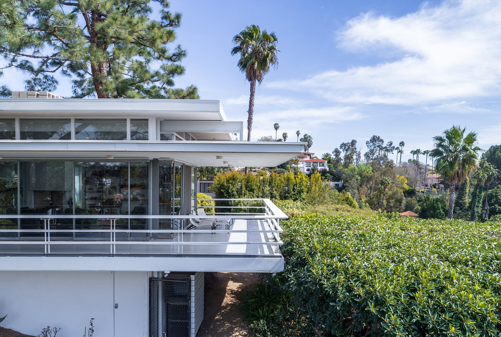 Exterior, Metal, House, Metal, Glass, Mid-Century, and Flat The wraparound deck provides stellar views and is perfect for entertaining.  Best Exterior Metal Mid-Century Photos from Rooney Mara Asks $3.45M For a Restored Midcentury Stunner in L.A.