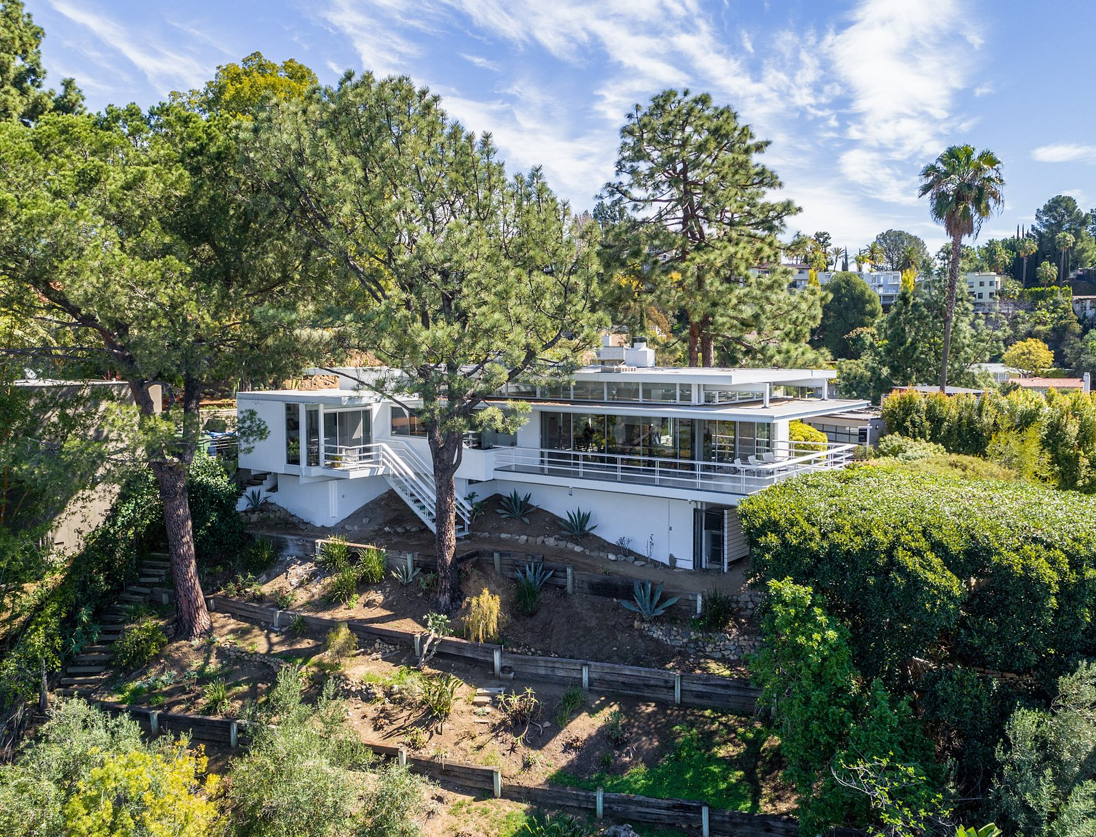 In addition to an expansive hillside garden the home also offers off-street parking for five cars.