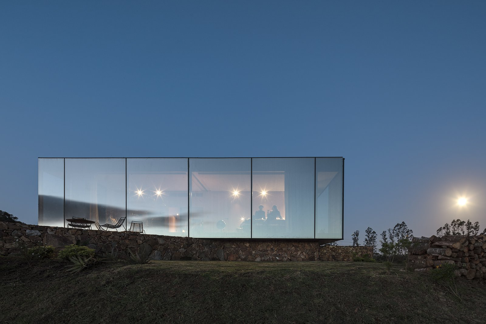 Exterior, Glass Siding Material, Prefab Building Type, Flat RoofLine, and Cabin Building Type The prefab cabin is an arresting sight at night.  Best Photos from A New Prefab Hotel in Uruguay Seems to Melt Into the Landscape