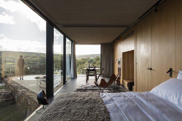 Fittingly sleek modern interiors use minimalist furnishings and feature light wood walls.