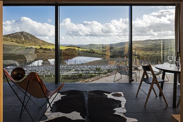 The wall of windows provides a stunning panoramic view of the local landscape.