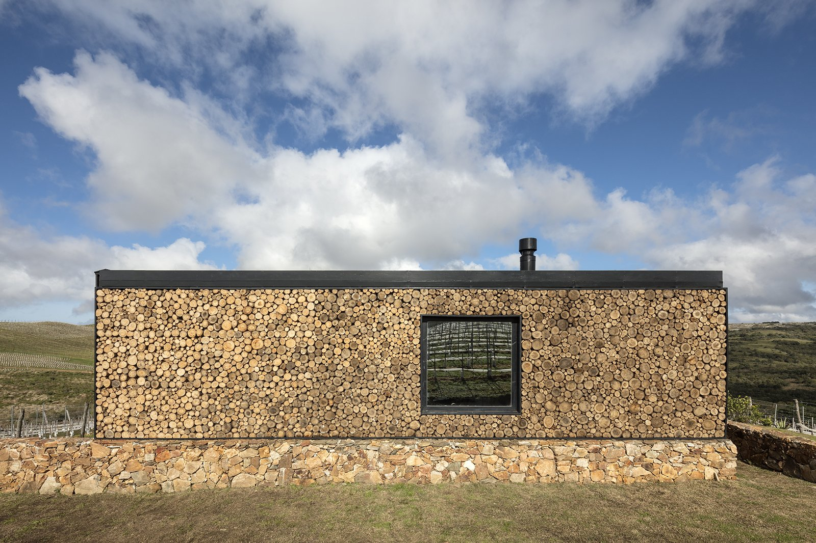 Exterior, Prefab Building Type, Flat RoofLine, and Wood Siding Material Local materials were used for onsite works such as cut timber trunks for the rear wall and locally sourced stone for the platforms.  Best Photos from A New Prefab Hotel in Uruguay Seems to Melt Into the Landscape