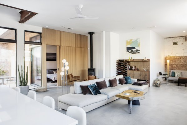 A long sofa in the center faces a coffee table topped with a slab of elm that was designed by Moss.