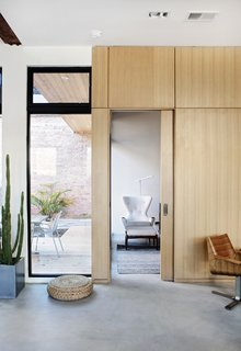 The studio also created the sliding wooden doors that open into the master bedroom.