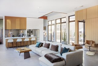 The open plan great room is bright and airy thanks to the insertion of the center courtyard .