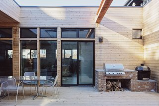 Cedar siding elevates the look of the center courtyard which is a perfect spot for entertaining.