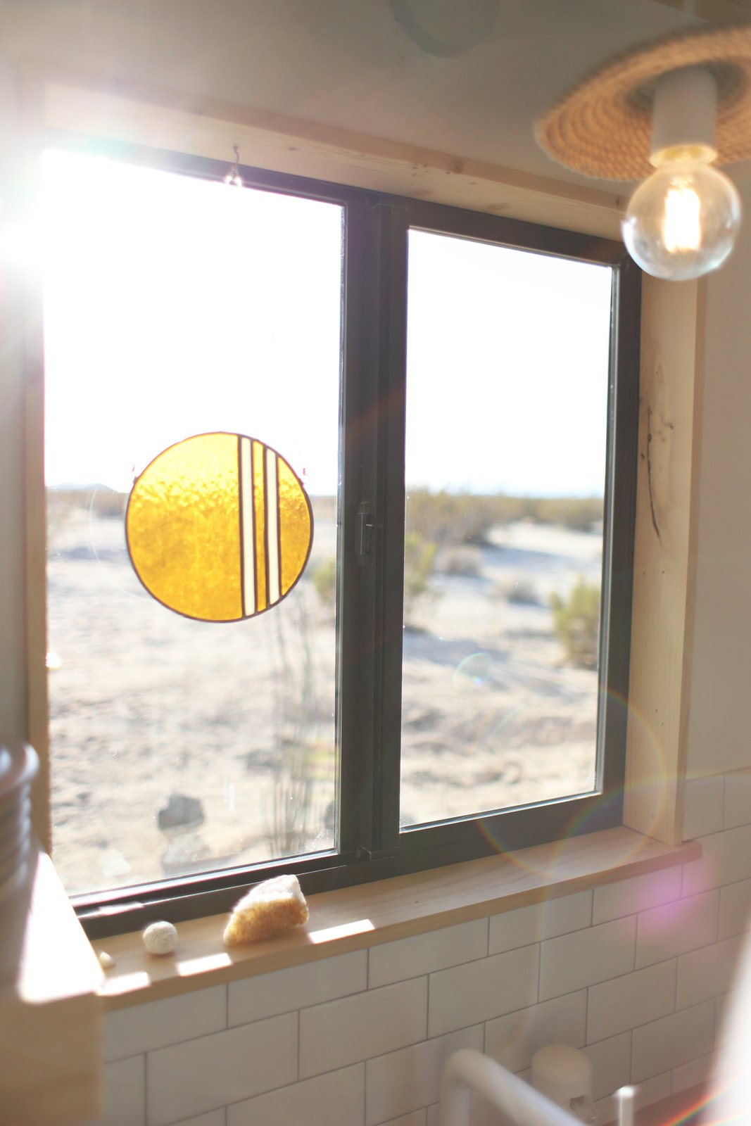 Windows, Metal, and Sliding Window Type Kathrin is also a stained glass artist and this piece is from her collection called Bands of Color.  Photo 13 of 15 in A Couple Buy a Collapsing Cabin For $7K in Joshua Tree and Revamp it Into a Desert Oasis