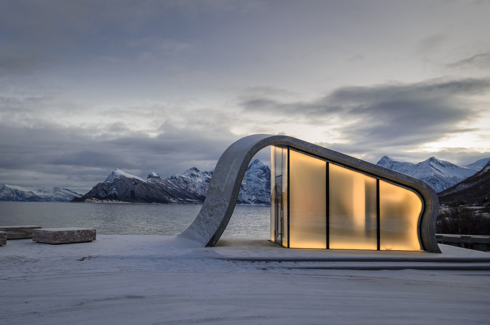 Exterior, Curved RoofLine, Glass Siding Material, and Concrete Siding Material The smoothness of the poured concrete is strikingly juxtaposed against the rugged surrounding terrain.  Photo 9 of 9 in This Concrete Rest Stop Will Make You Want to Visit Norway