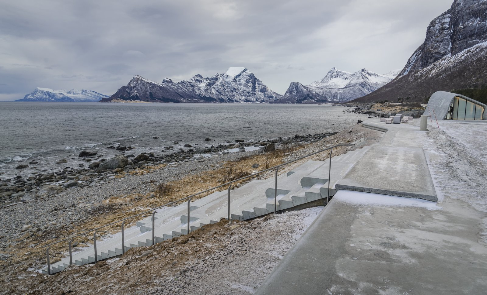 Staircase, Concrete Tread, and Metal Railing The amphitheater-style seating leads down to the beach area and provides stunning panoramic views of the fjord.  Photo 5 of 9 in This Concrete Rest Stop Will Make You Want to Visit Norway