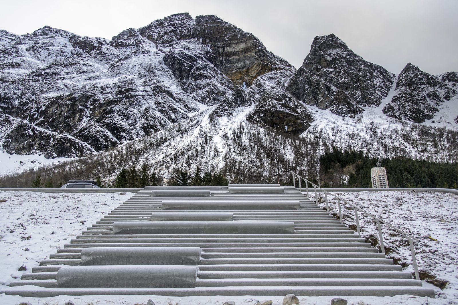 Staircase, Concrete Tread, and Metal Railing The views of the fjord are magnificent, both facing the vast open Norwegian ocean as well as looking towards the mountain.  Photo 6 of 9 in This Concrete Rest Stop Will Make You Want to Visit Norway
