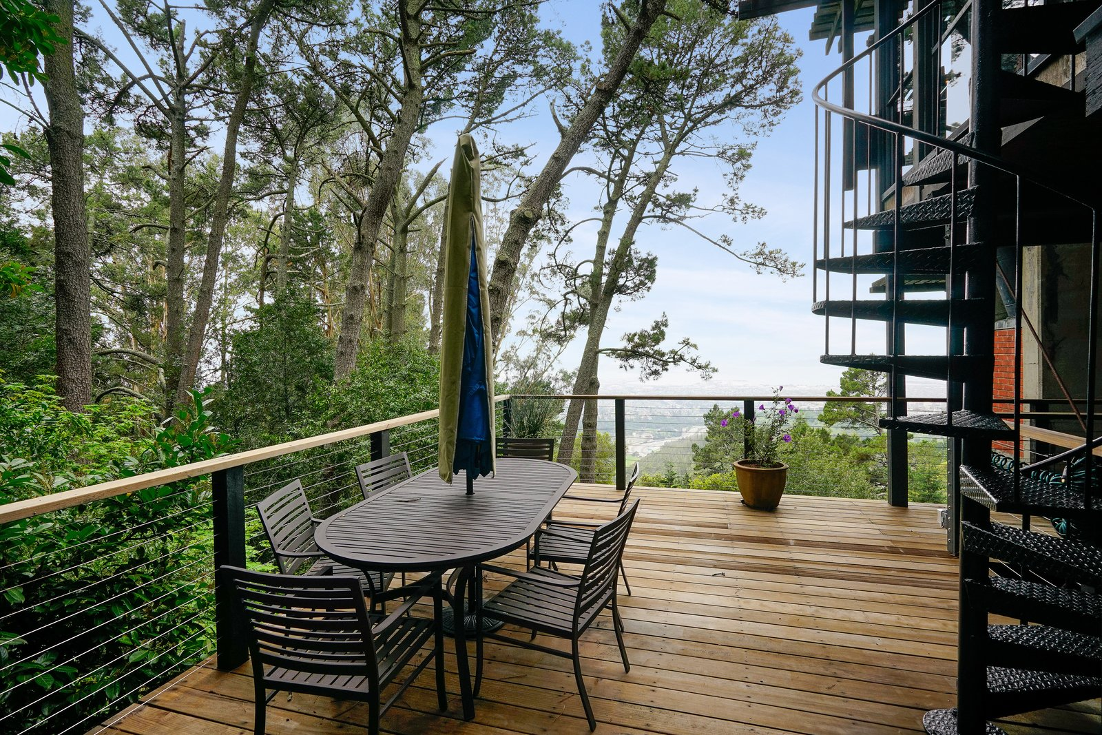 Outdoor, Small Patio, Porch, Deck, Trees, Side Yard, and Wood Patio, Porch, Deck The decks and balconies that take full advantage of the sylvan setting and the stunning views.  Photo 14 of 17 in This Knockout Midcentury in the Bay Area Will Run You $1.9M
